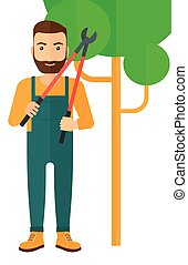 Farmer with pruner - A hipster farmer with a beard holding a...