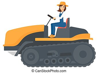 Farmer driving catepillar tractor - A farmer driving a...