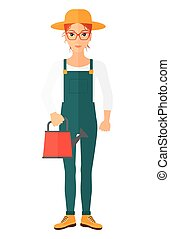 Farmer with watering can - A farmer holding a watering can...
