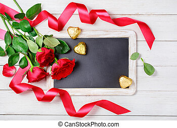 Valentine and 39;s Day background - Red roses, candy and...
