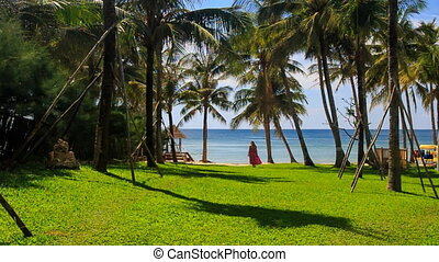 Blond Girl in Red Moves on Beach by Lawn in City Palm Park -...