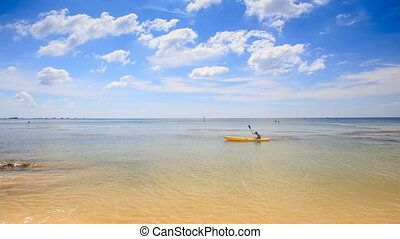 Guy Paddles Kayak along Shallow Transparent Sea - guy...