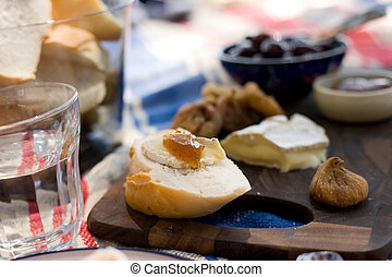 Outdoor Summer Beach Picnic - A cheese plate on a picnic rug