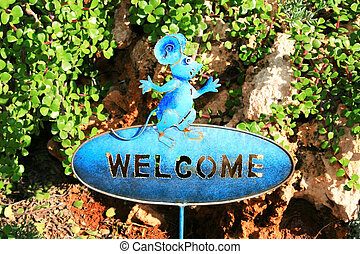 Mouse - Welcome sign with metallic mouse.