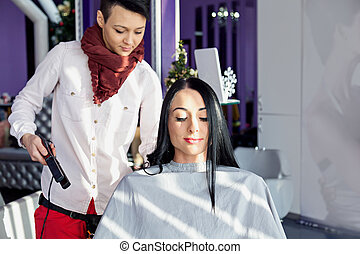 girl with long black hair in a barber chair..