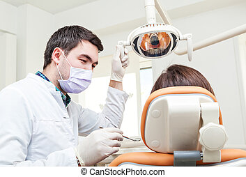 treatment at the dental clinic. Inspection