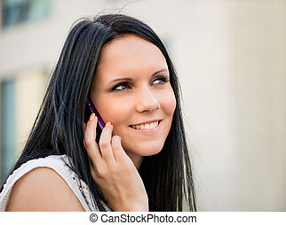 Get connected - Young beautiful woman calling mobile phone
