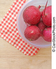 Beetroot on red tablecloth background