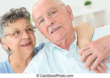 elderly couple posing