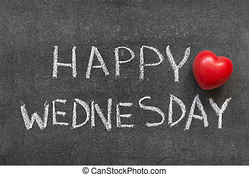 happy Wednesday phrase handwritten on blackboard with heart...