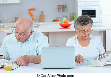 elderly couple apart