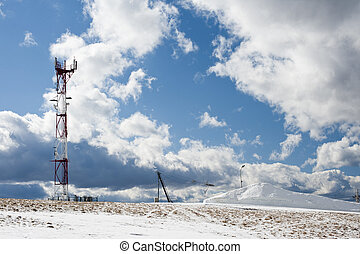 GSM tower in winter mountains