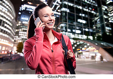 Runner in the city - Young runner with smart phone in the...