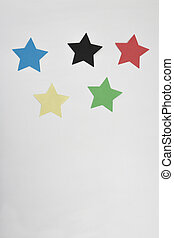 olympic games stars - a vertical overhead view of five paper...
