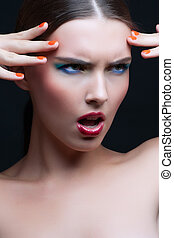 portrait of a beautiful young woman with fashion make up