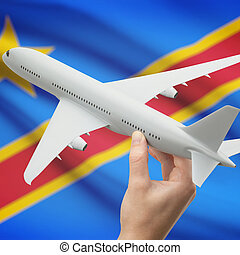 Airplane in hand with flag on background - Congo-Kinshasa -...