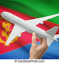 Airplane in hand with flag on background - Eritrea -...