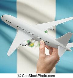 avión, en, mano, con, bandera, en, Plano de fondo, -,...