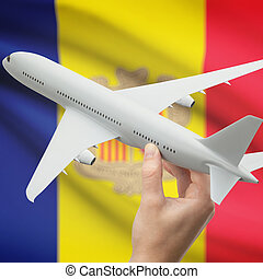 Airplane in hand with flag on background - Andorra -...
