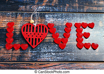 the word LOVE made of red candies and heart - the word LOVE...
