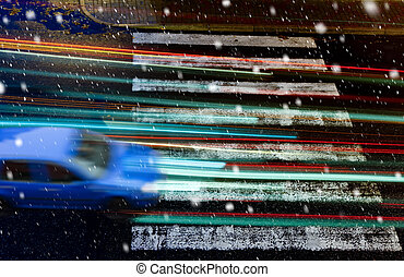 car on the pedestrian crossing in the snowfall - blue car on...