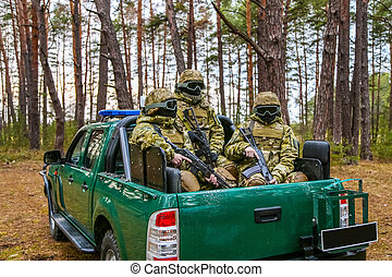 Special Forces in the back of a pickup