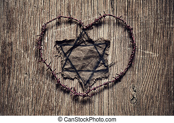 Jewish badge and barbed wire forming a heart - closeup of a...