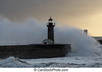 Stormy waves at winter sunset - Big stormy waves over pier...