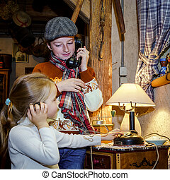 Two sisters playing with old vintage telephon, communication...