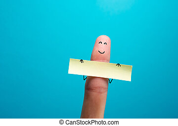 Funny finger holding blank bunner showing on it and smiling...