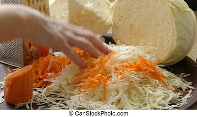mixing of chopped cabbage ,carrot - the process of mixing...