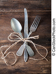 old vintage cutlery on a wooden table