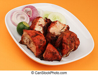 A plate of chopped Tandoori Chicken with some garnishing on...
