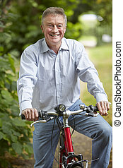 Senior Man Enjoying Cycle Ride