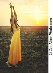 Happy young woman dancing and praising nature. - Happy young...