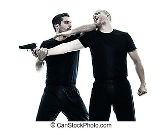 men krav maga fighters fighting isolated - two caucasian men...