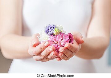 Fresh flowers in woman hand. Concept of beauty and spa,...