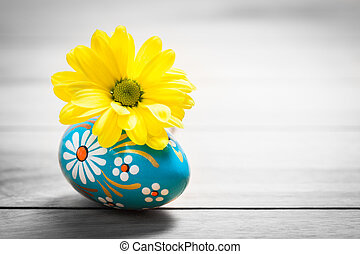 Hand painted Easter egg and spring daisy flower on wood...