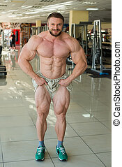 Muscular bodybuilder - Muscular bodybuilder in gum Strong...