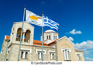Waving flag of Cyprus and Greece with Orthodox church on the...