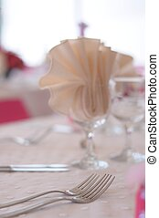 table with fork, spoon and knife - beauty pink roses