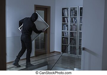 Robber in black mask - Image of robber in black mask...