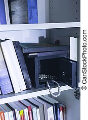 Safe with expensive jewellery - Image of open safe with...