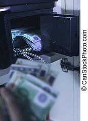Safe with money and pearl - Photo of domestic safe with...