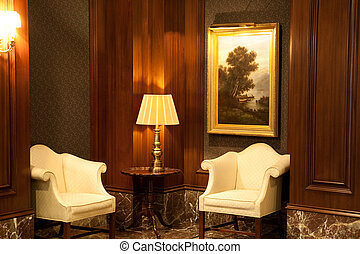 White Chairs and Lamp in Corner of Lobby