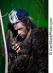 Portrait muscular werewolf with dreadlocks with long nails...