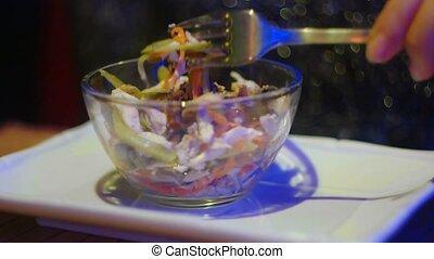 Macro eating china salad in dark room - Macro eating asian...