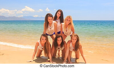 closeup cheerleaders show simple pyramid on all fours wave...