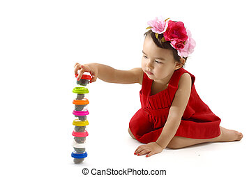 Cute little girl making from plasticine box, isolated on...