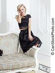 stylish elegant blonde woman in beauty rich interior,...